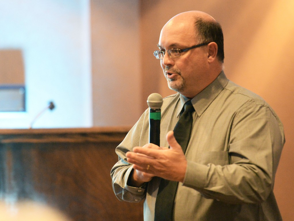 Eric Dodrill, District Director of the Erie Conservation District, gives a presentation about partnerships during the District's annual meeting and dinner at the Sandusky State Theatre on Wednesday. Register photo/JILLY BURNS