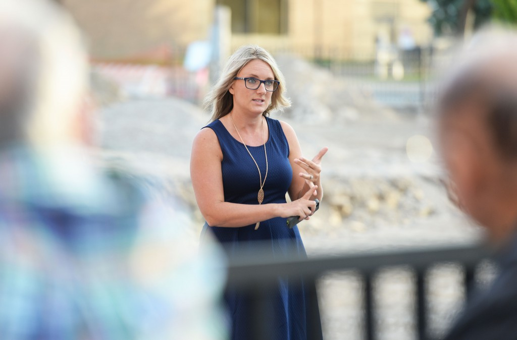 Sharing information about green infrastructure plans in the City of Sandusky, Melissa Fetter, Urban Conservation Technician at the Erie Conservation District, gives a tour of the parking lot off of Jackson Street in downtown Sandusky on Wednesday. Register photo/JILLY BURNS
