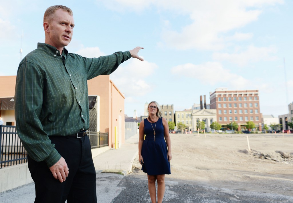 City of Sandusky Director of Public Works Aaron Klein talks about the construction of green infrastructure, such as pervious pavement, at the parking lot off of Jackson Street in downtown Sandusky. Register photo/JILLY BURNS