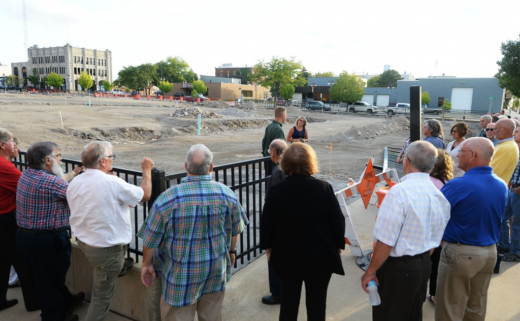 A crowd gathers from the Erie Conservation District dinner and annual meeting on Wednesday to learn about green infrastructure being installed at the parking lot off of Jackson Street in downtown Sandusky. Register photo/JILLY BURNS